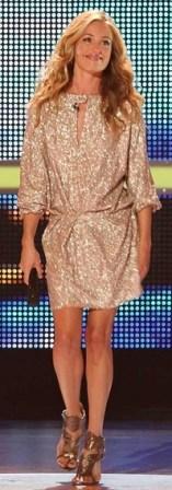 Cat Delay in gold sequin dress